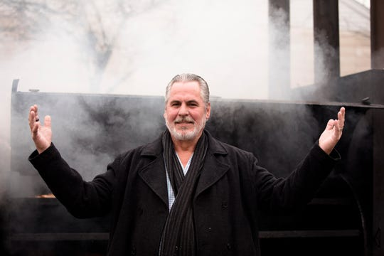Guy Cummins stands outside the smoker of his restaurant the Smokin' This and That BBQ on Thursday, Jan. 17, 2019 in Florence, Ky. Cummins' is offering free meals to any federally employee who is furloughed or not being paid due to the government shutdown.