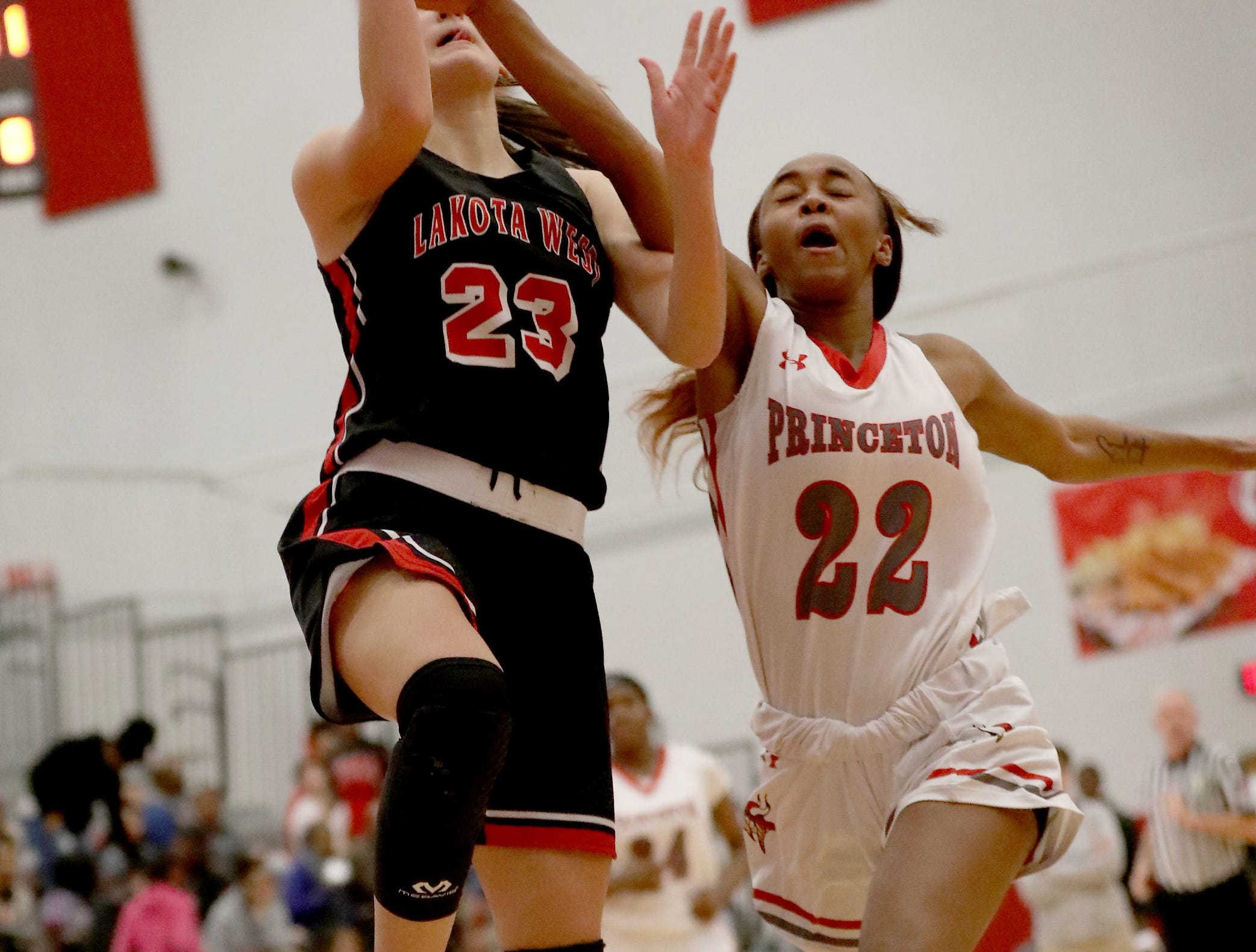 Lakota West forward Kailyn Dudukovich (23) drives to the basket against Princeton  guard Jacquelyn Hinesmon   during their basketball game, Wednesday, Jan.16,2019.