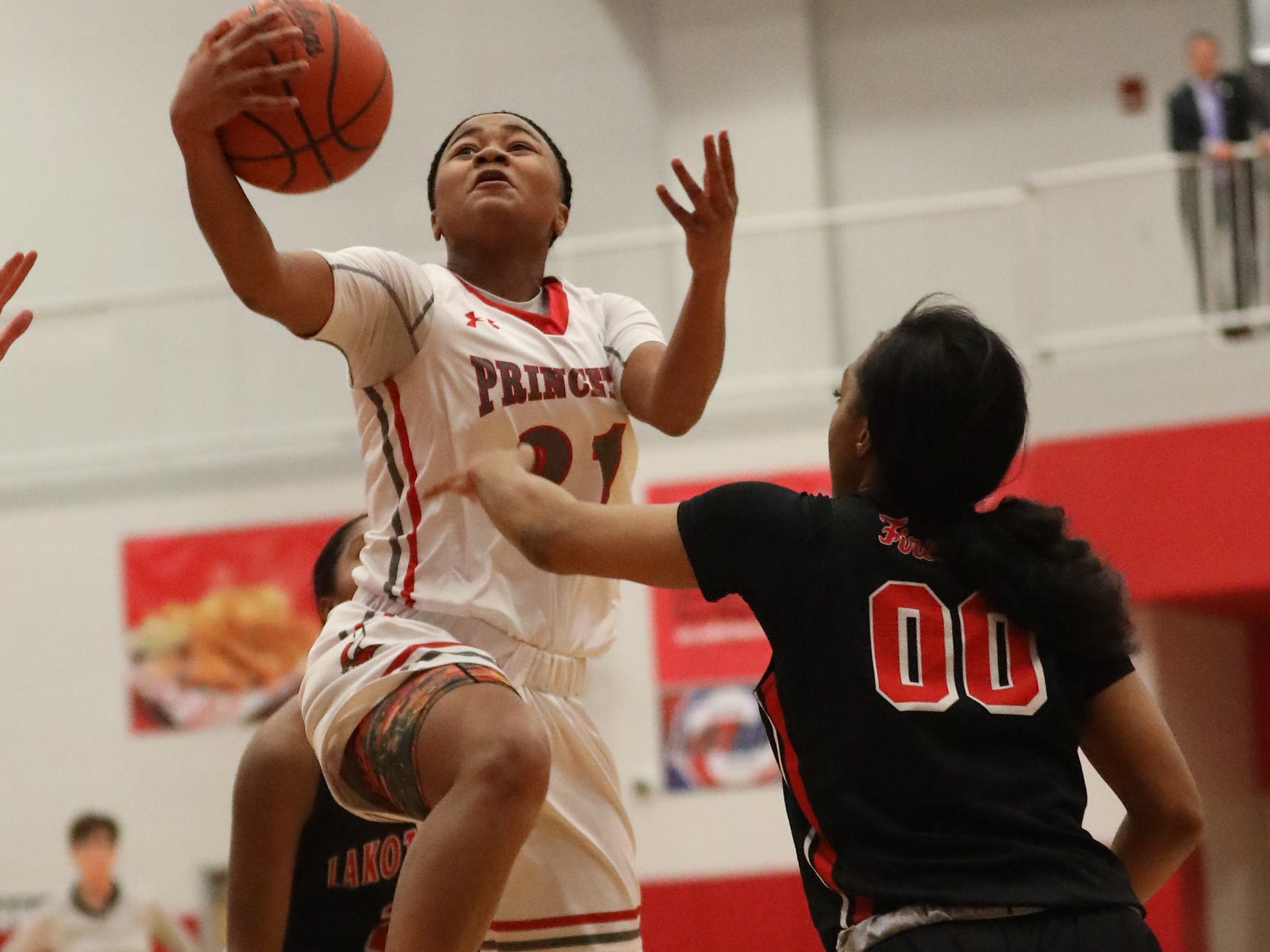 Princeton guard Willow White (21) drives to the basket during the Vikings' basketball game against Lakota West , Wednesday, Jan.16, 2019.