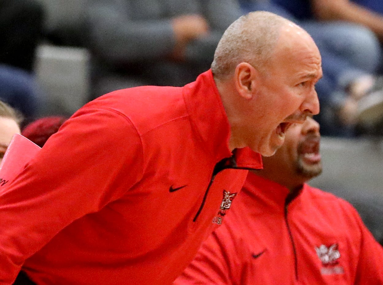 Lakota West head coach Andy Fishman reacts during the Firebireds' win over Princeton giving him his 400th win , Wednesday, Jan.16, 2019.