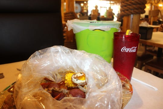 """The """"Juicy Special,"""" served in a bag with blue crab, sausage, potatoes and corn, is available at Jumbo Crab, a new seafood restaurant on Fort Campbell Boulevard that opened Jan. 11, 2019."""