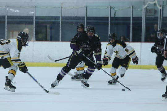 Sam Fishteyn skates with the puck in a game against South Brunswick last season