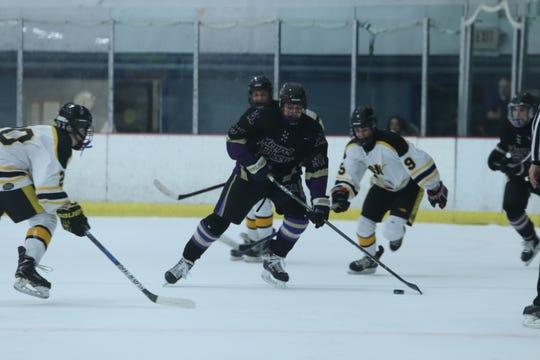 Sam Fishteyn skates with the puck in a game against South Brunswick last season