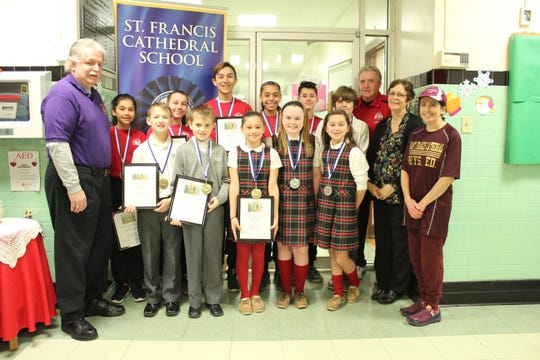 Congratulations to St. Francis Cathedral students who won the annual Metuchen Elks Soccer Shoot Out contest.  Pictured from left to right in the front row are:  Mike Walsh, Metuchen Elks #1914, Aidan Quinn, Jimmy Cassalia, Ashley Bojar, Emily Miller, Fiorella Perone, Principal Ann Major, Physical Education Teacher Carolyn Roberts.  In the back row from left to right is:  Angelina Lozano, Francesca Corea, Alejandro Ruiz, Angelina Vargas, Raymond Perone, John Risley, Nick Dorschenko, Metuchen Elks #1914. Not pictured is Christian Johnson.