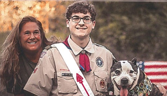 Shane Anthony Holub of Olive Branch, Mississippi with his mother and pet, recent received his Eagle Scout badge.