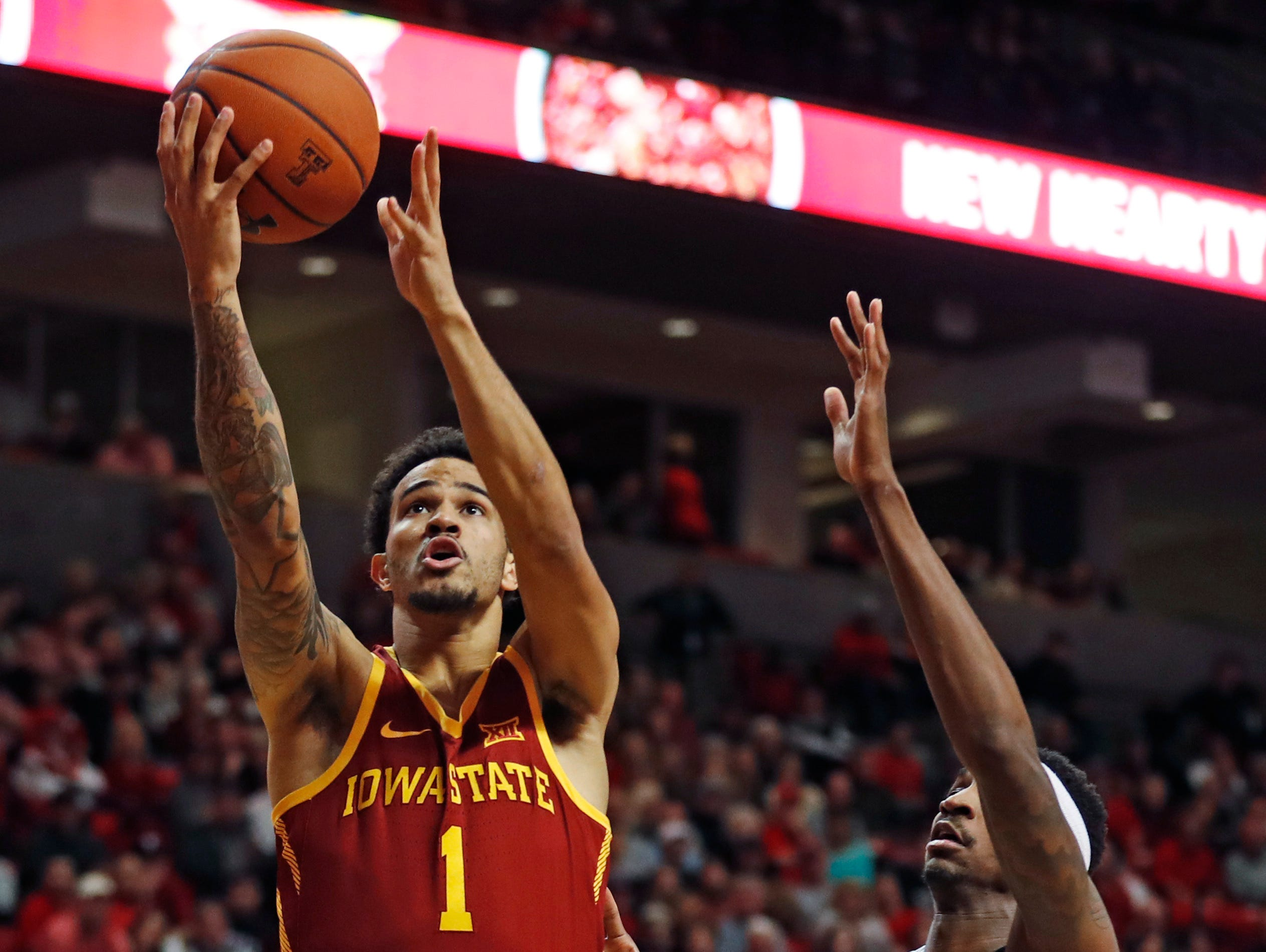 Iowa State's Nick Weiler-Babb (1) lays up the ball in front of Texas Tech's Tariq Owens (11) during the second half of an NCAA college basketball game Wednesday, Jan. 16, 2019, in Lubbock, Texas.