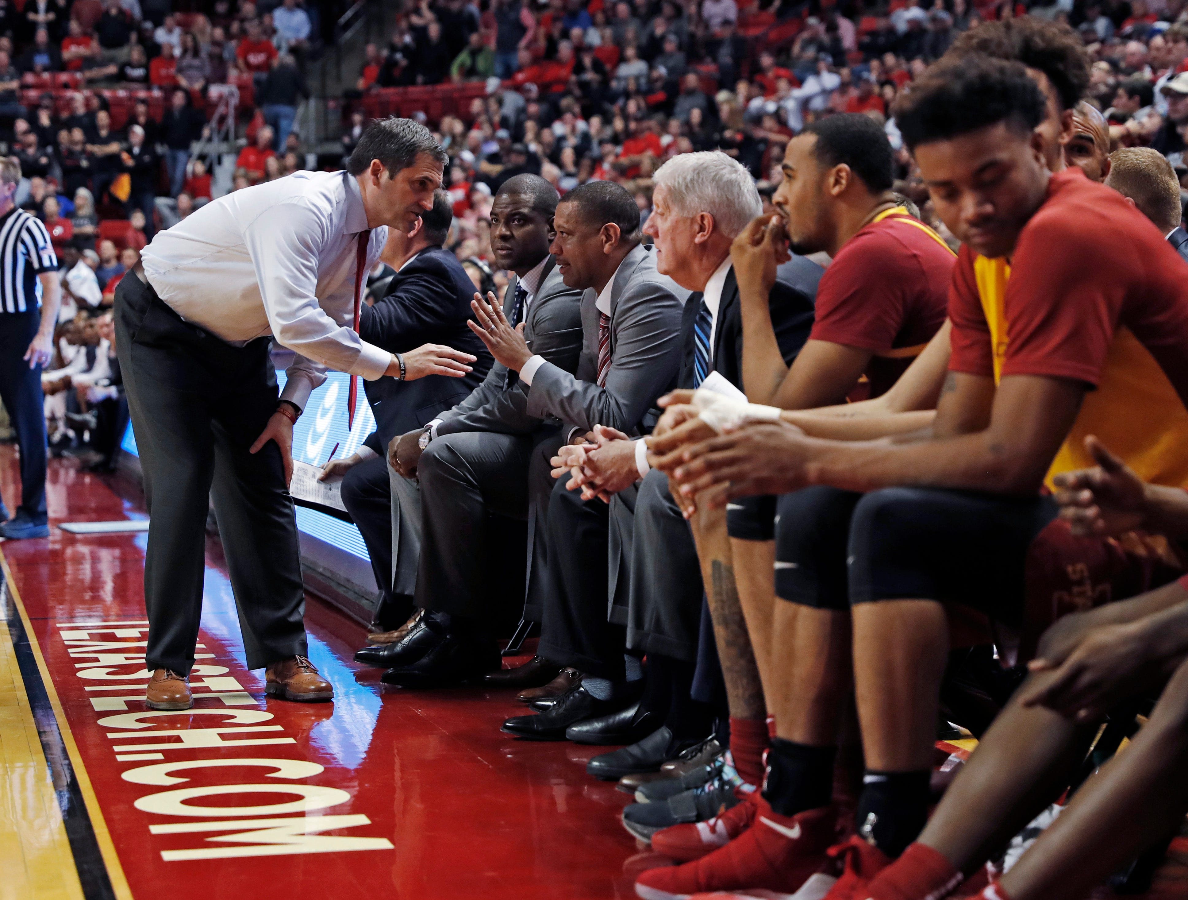 Iowa State coach Steve Prohm talks to his assistants during the second half of an NCAA college basketball game against Texas Tech, Wednesday, Jan. 16, 2019, in Lubbock, Texas.