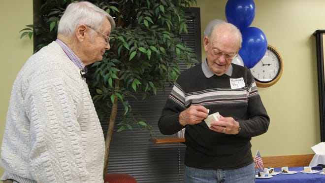 Ted Williams, right, was given his second-place Drake Relays medal by fellow 1944 Drake Relays competitor and World War II veteran Bob Clark, left, during his 93rd birthday party on Thursday.