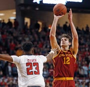 Iowa State's Michael Jacobson (12) shoots over Texas Tech's Jarrett Culver (23) during the first half of an NCAA college basketball game Wednesday, Jan. 16, 2019, in Lubbock, Texas.