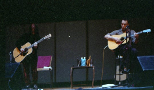 Tim Reynolds, left, and Dave Matthews perform Feb. 27, 1999, at Luther College in Decorah, Iowa.