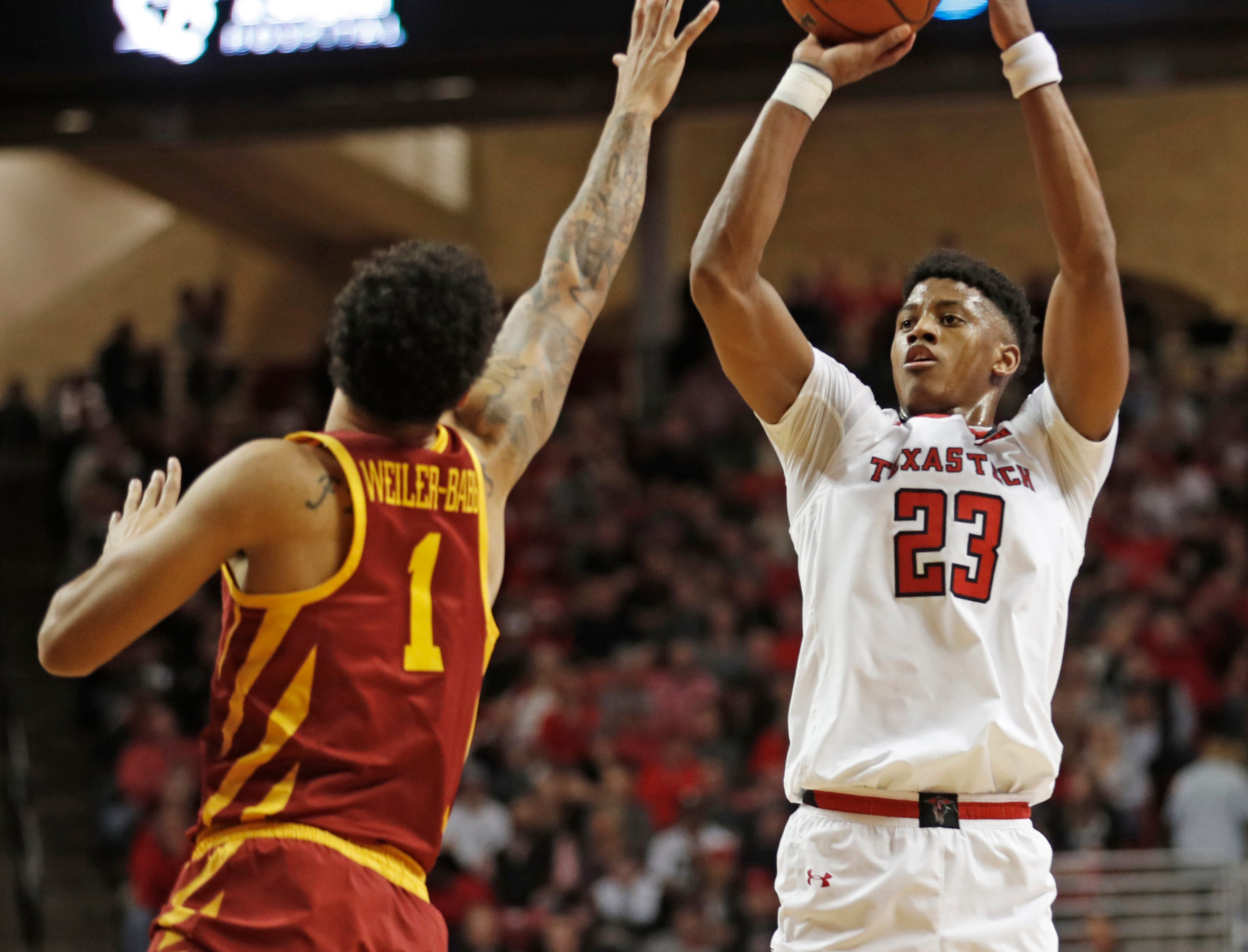 Texas Tech's Jarrett Culver (23) shoots over Iowa State's Nick Weiler-Babb (1) during the first half of an NCAA college basketball game Wednesday, Jan. 16, 2019, in Lubbock, Texas.