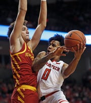 Texas Tech's Kyler Edwards (0) tries to shoot around Iowa State's George Conditt IV during the second half of their game Wednesday, Jan. 16, 2019, in Lubbock, Texas.