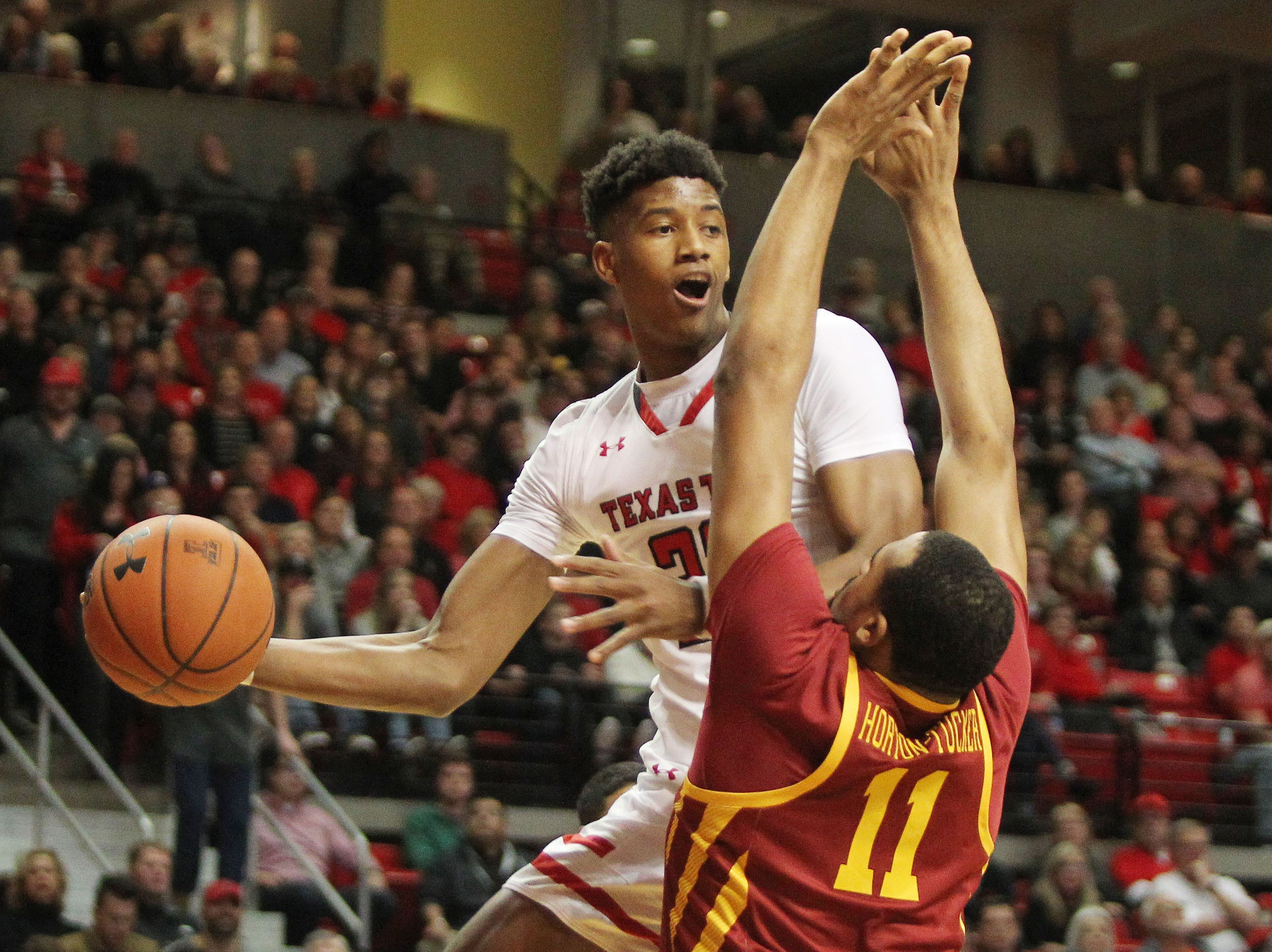 Jan 16, 2019; Lubbock, TX, USA; Texas Tech Red Raiders guard Jarrett Culver (23) passes the ball around Iowa State Cyclones guard Talen Horton-Tucker (11) in the first half at United Supermarkets Arena.