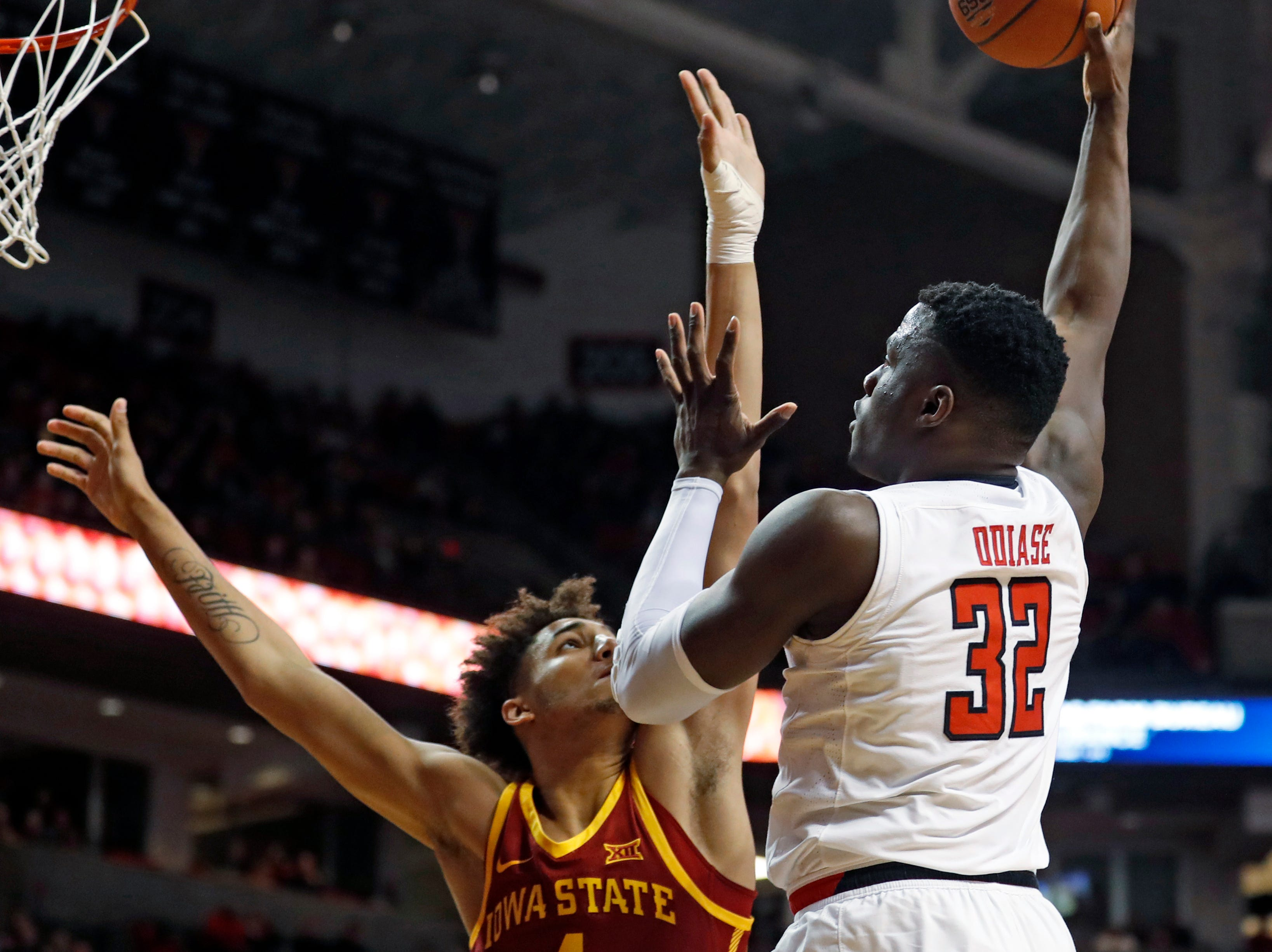 Texas Tech's Norense Odiase (32) shoots over Iowa State's George Conditt IV during the first half of an NCAA college basketball game Wednesday, Jan. 16, 2019, in Lubbock, Texas.
