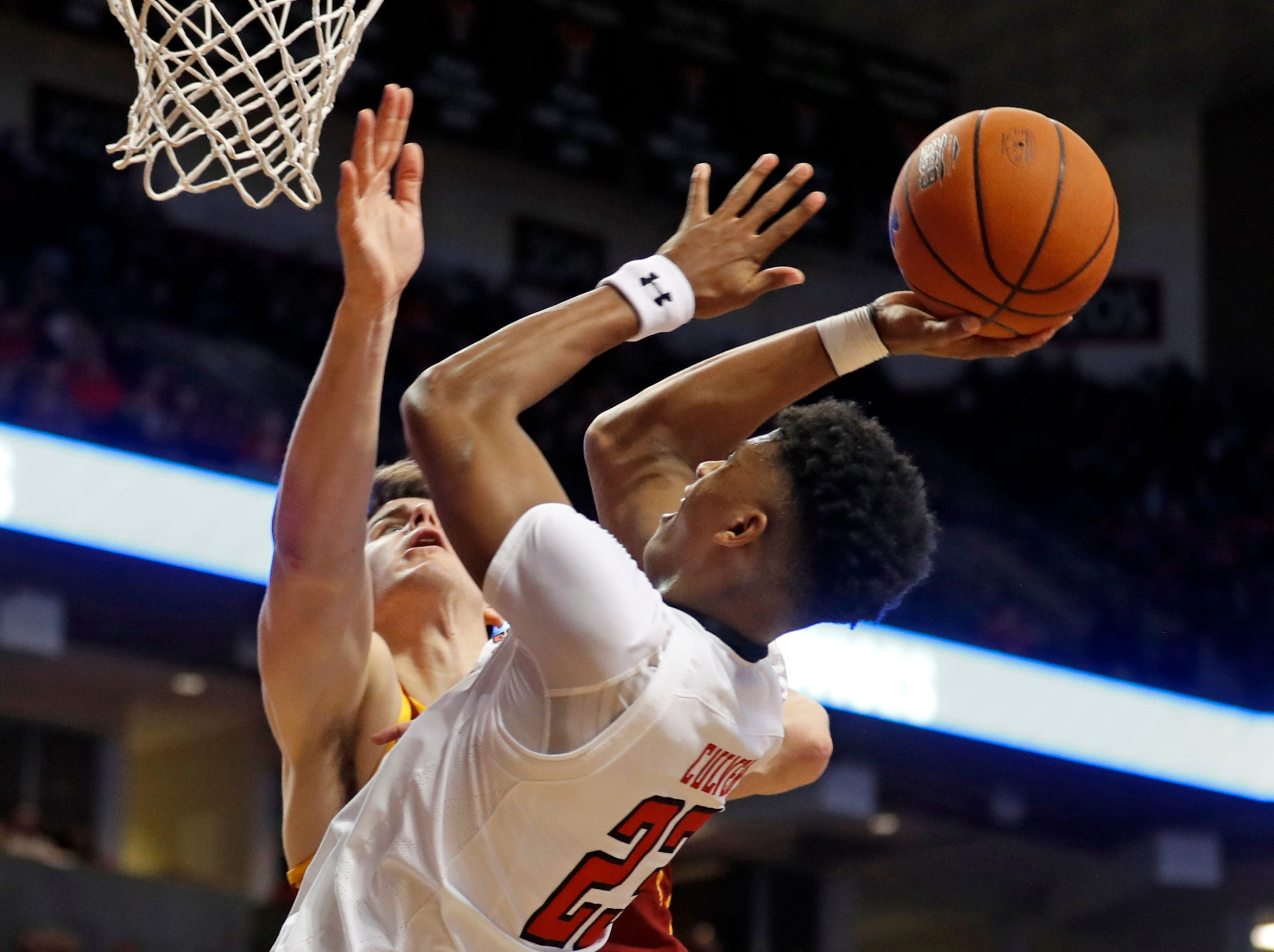 Texas Tech's Jarrett Culver (23) shoots as he is fouled by Iowa State's Michael Jacobson during the first half of an NCAA college basketball game Wednesday, Jan. 16, 2019, in Lubbock, Texas.