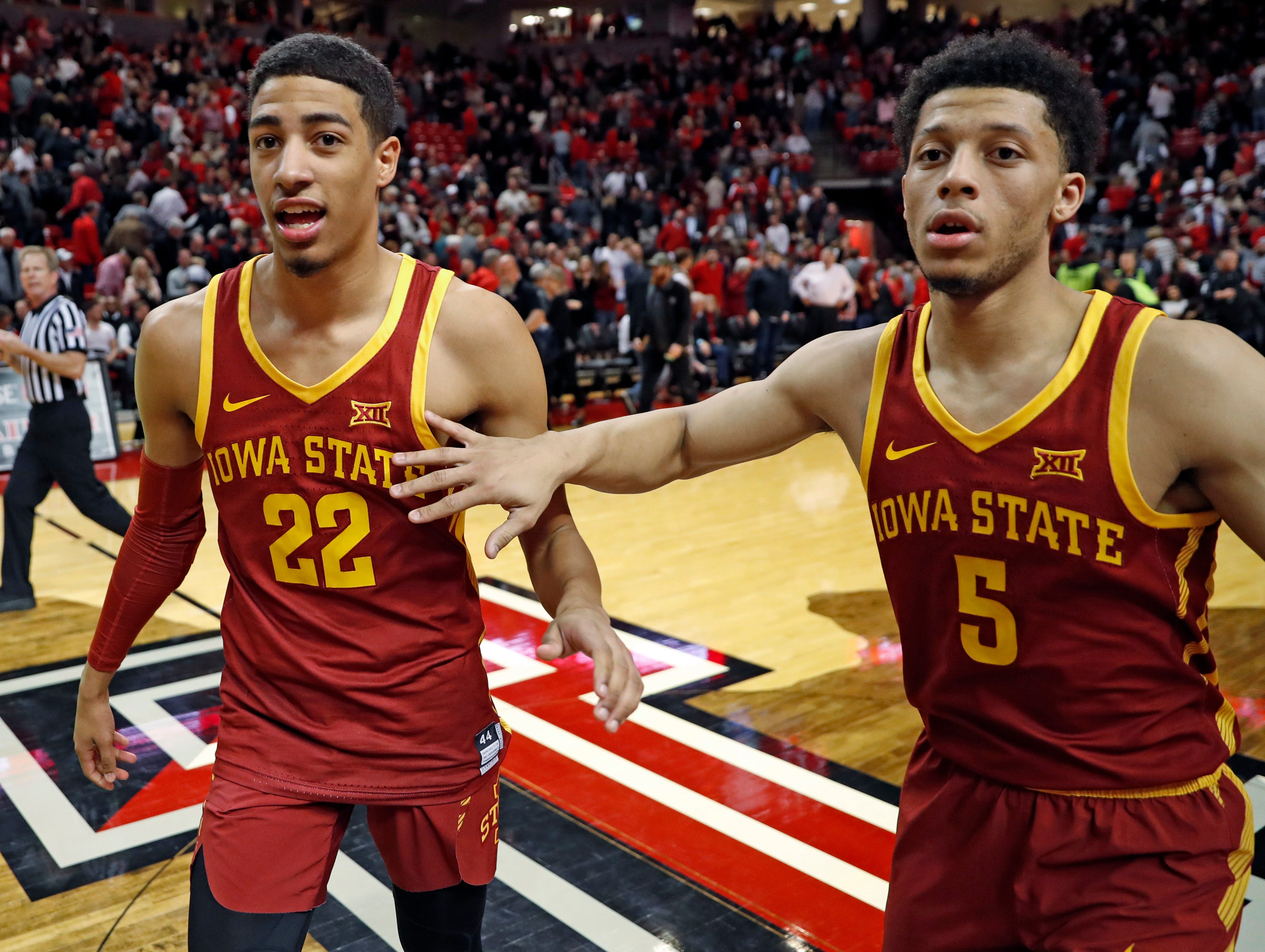 Iowa State's Tyrese Haliburton (22) and Lindell Wigginton (5) celebrate after the team's NCAA college basketball game against Texas Tech, Wednesday, Jan. 16, 2019, in Lubbock, Texas.