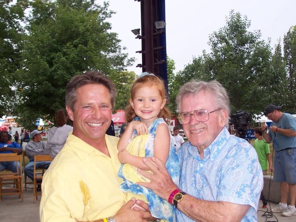 From left: Bill Riley Jr., Lily Gast, and Bill Riley Sr. at the Iowa State Fair.