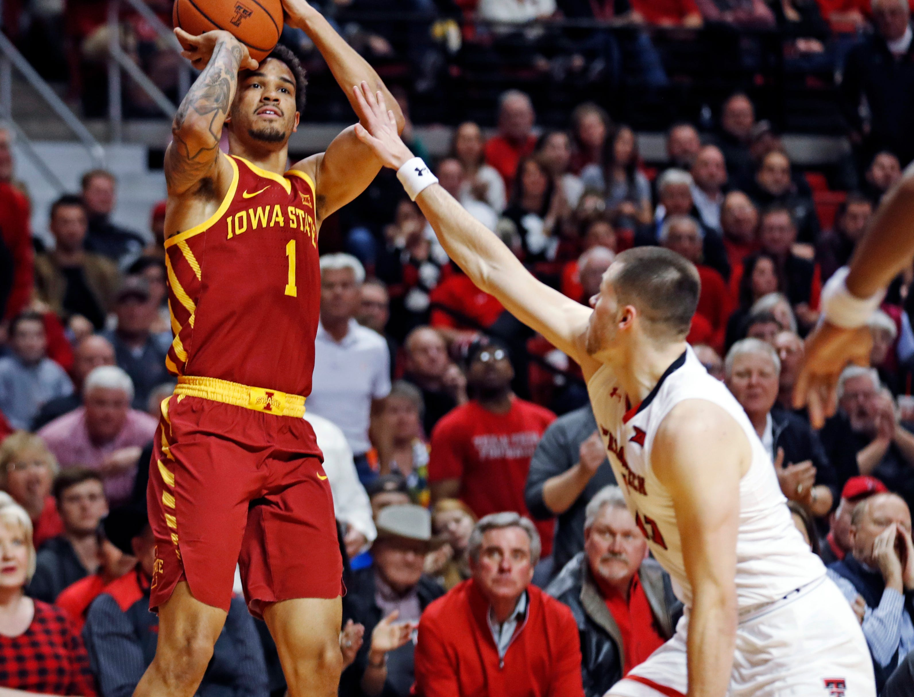 Iowa State's Nick Weiler-Babb (1) shoots over Texas Tech's Matt Mooney (13) during the second half of an NCAA college basketball game Wednesday, Jan. 16, 2019, in Lubbock, Texas.