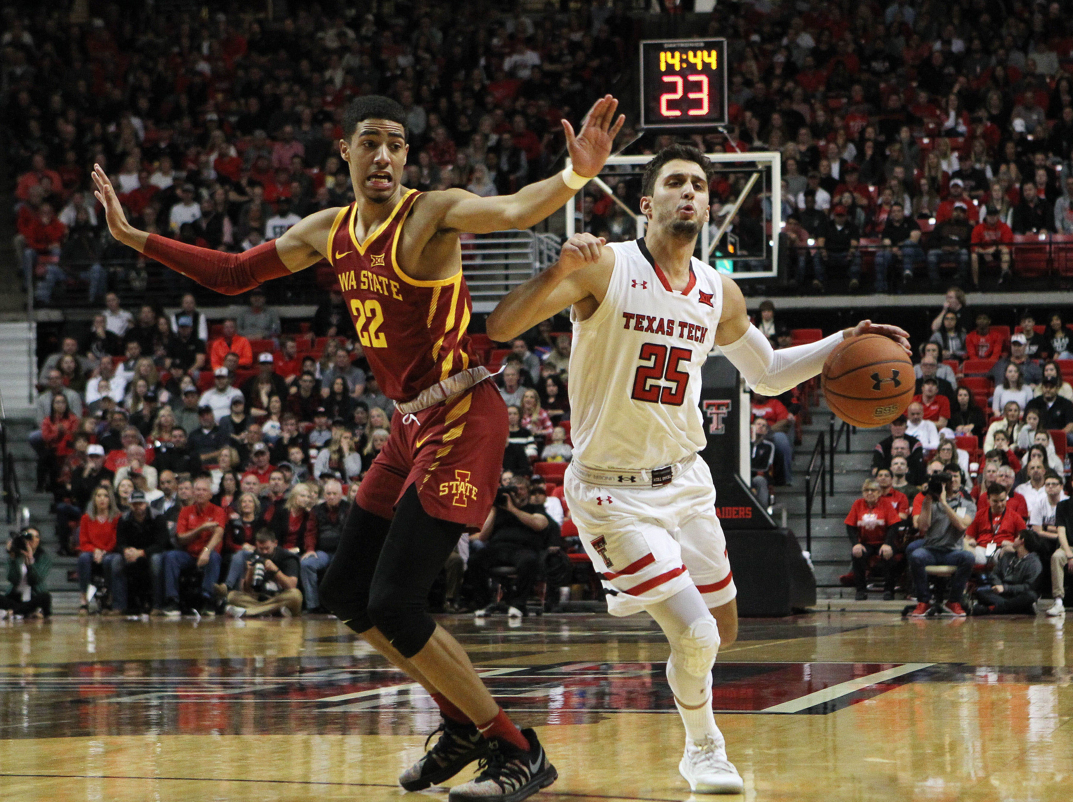 Jan 16, 2019; Lubbock, TX, USA; Texas Tech Red Raiders guard Davide Moratti (25) dribbles the ball around Iowa State Cyclones guard Tyrese Haliburton (22) in the first half at United Supermarkets Arena.