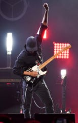 Tom Morello raises his fist in the arm during a solo during the