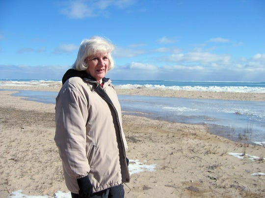 Joan Glass walks along the Lake Huron shore in Alcona County, Mich., on Friday, Feb. 18, 2005. Glass sued her neighbors across U.S. 23, who owned property on the Lake Huron shoreline, after they repeatedly interfered with her access to the lake. The Michigan Supreme Court in 2005 affirmed Glass', and all citizens', right to access the Great Lakes shoreline. Glass died in 2010.