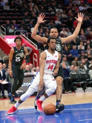Detroit Pistons guard Ish Smith drives against Orlando Magic guard Isaiah Briscoe during second quarter action Wednesday, January 16, 2019 at Little Caesars Arena in Detroit, Mich.
