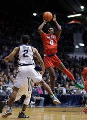 Detroit Mercy's Antoine Davis shoots against Butler's Aaron Thompson during the second half of an NCAA college basketball game, Monday, Nov. 12, 2018, in Indianapolis. Butler won 84-63. (AP Photo/Darron Cummings)
