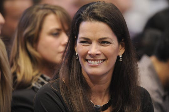 In this Feb. 28, 2011, photo, former Olympic figure skater Nancy Kerrigan watches an exhibition tennis match between Pete Sampras and Andre Agassi at Madison Square Garden in New York. It's been 25 years since Kerrigan was clubbed after practice by a member of a bumbling goon squad hired by Tonya Harding's ex-husband with the hope of eliminating his former wife's top competition for the U.S. Olympic team.