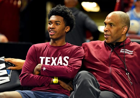 Texas Southern Tigers head coach Mike Davis (right) sits with his son Antoine Davis during practice for the first round of the 2017 NCAA Tournament at Bon Secours Wellness Arena.