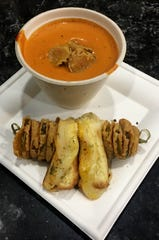 Tomato-basil soup with grilled-cheese sandwiches and fried pickles are among the food court offerings.