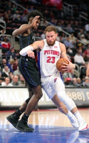 Detroit Pistons forward Blake Griffin drives against Orlando Magic forward Jonathan Isaac during first quarter action Wednesday, January 16, 2019 at Little Caesars Arena in Detroit, Mich.