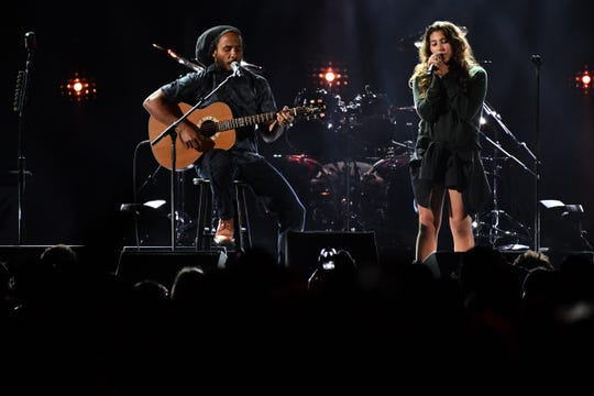 "Ziggy Marley and Chris Cornell's daughter Toni perform his father's  reggae classic ""Redemption Song."""