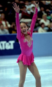 Michelle Kwan, a 13-year-old rising star from Torrance, Calif., reacts during her performance in the championship ladies free skating event during the U.S. Figure Skating Championships Saturday, Jan. 8, 1994, in Detroit. Kwan finished second overall but will be bumped from the Olympic team by Nancy Kerrigan.