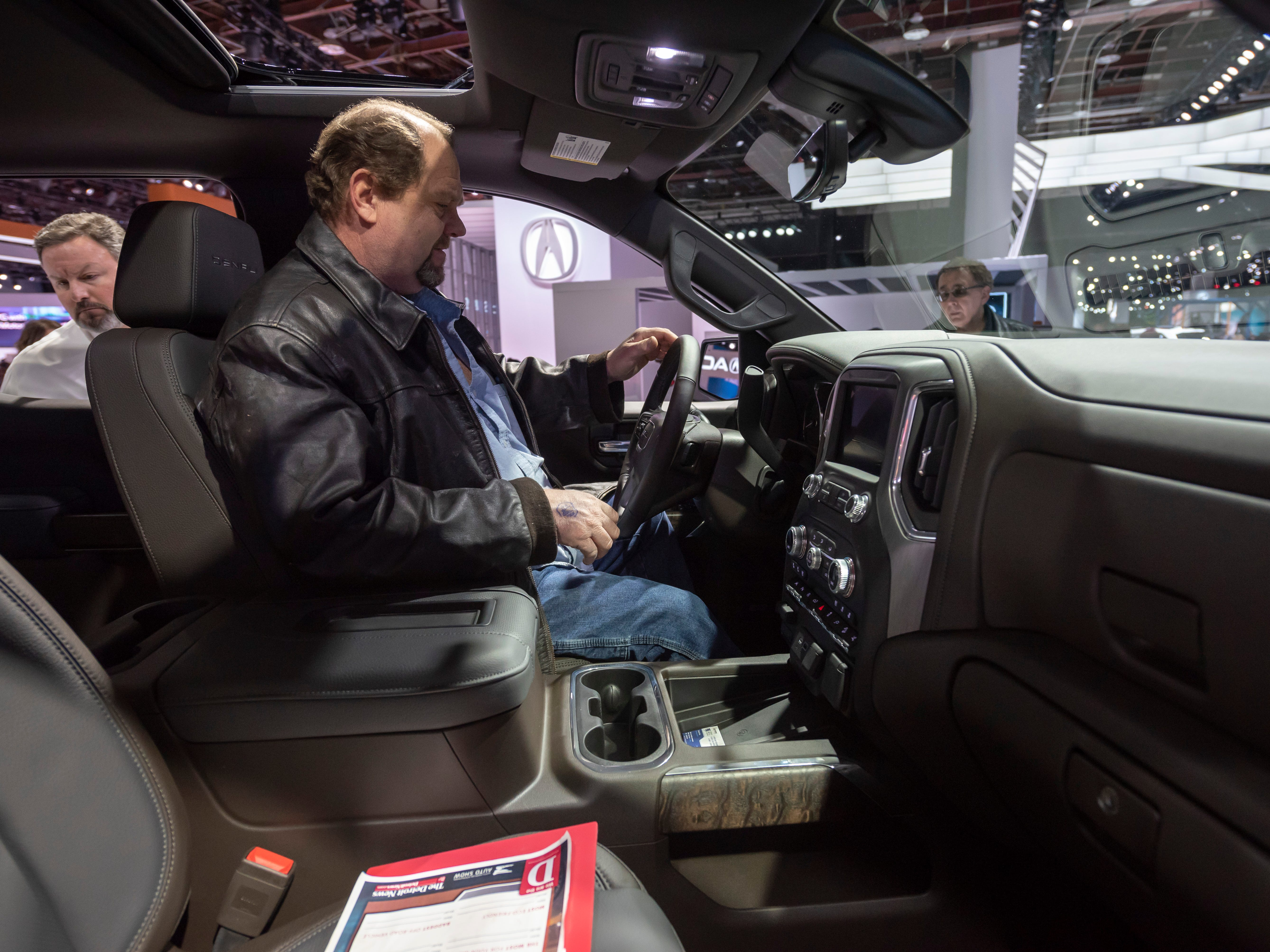 Judge David Felker of Oak Park checks out the GMC Denali Sierra.