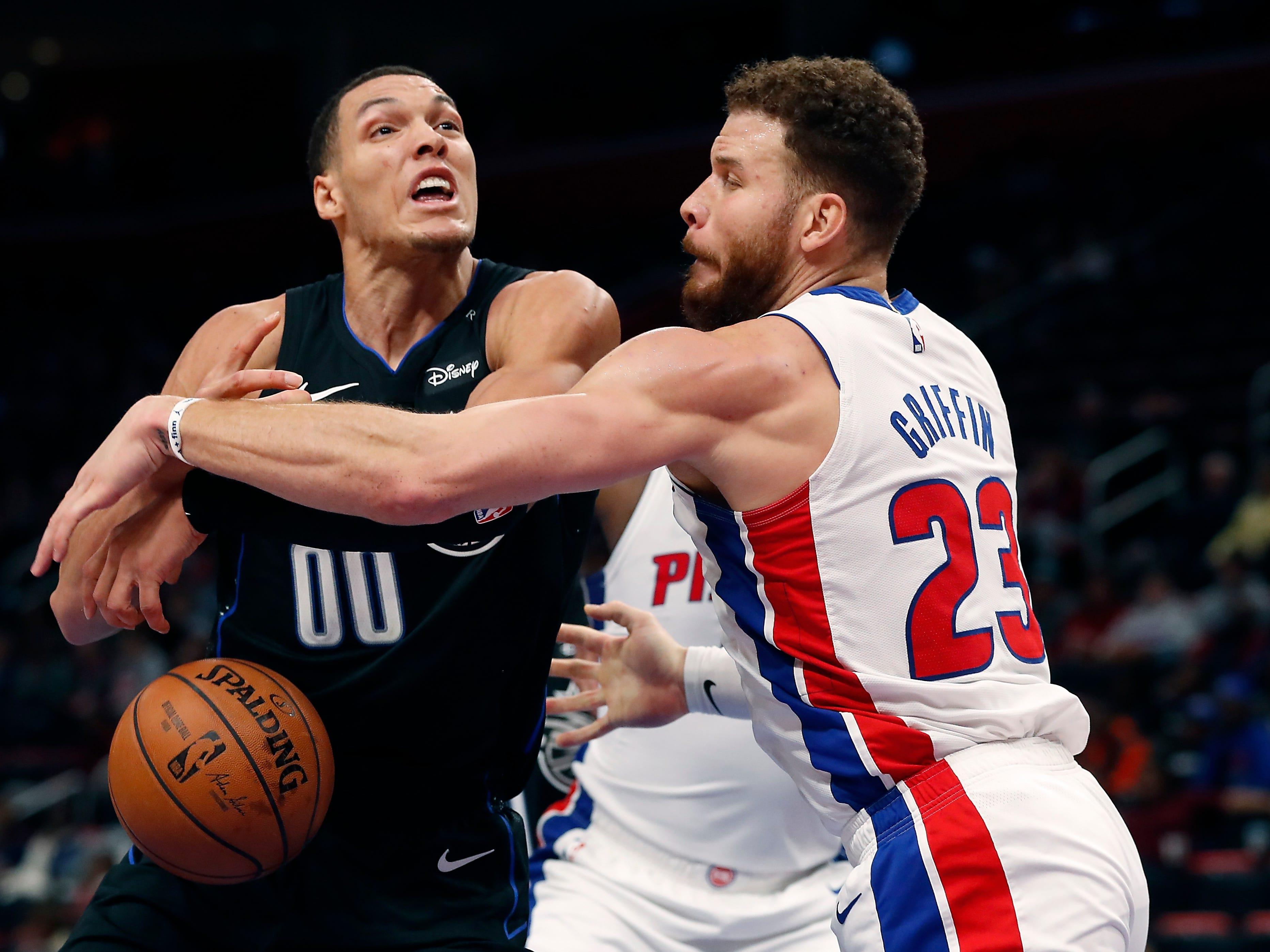 Detroit Pistons forward Blake Griffin (23) knocks the ball away from Orlando Magic forward Aaron Gordon (00) during the second half.