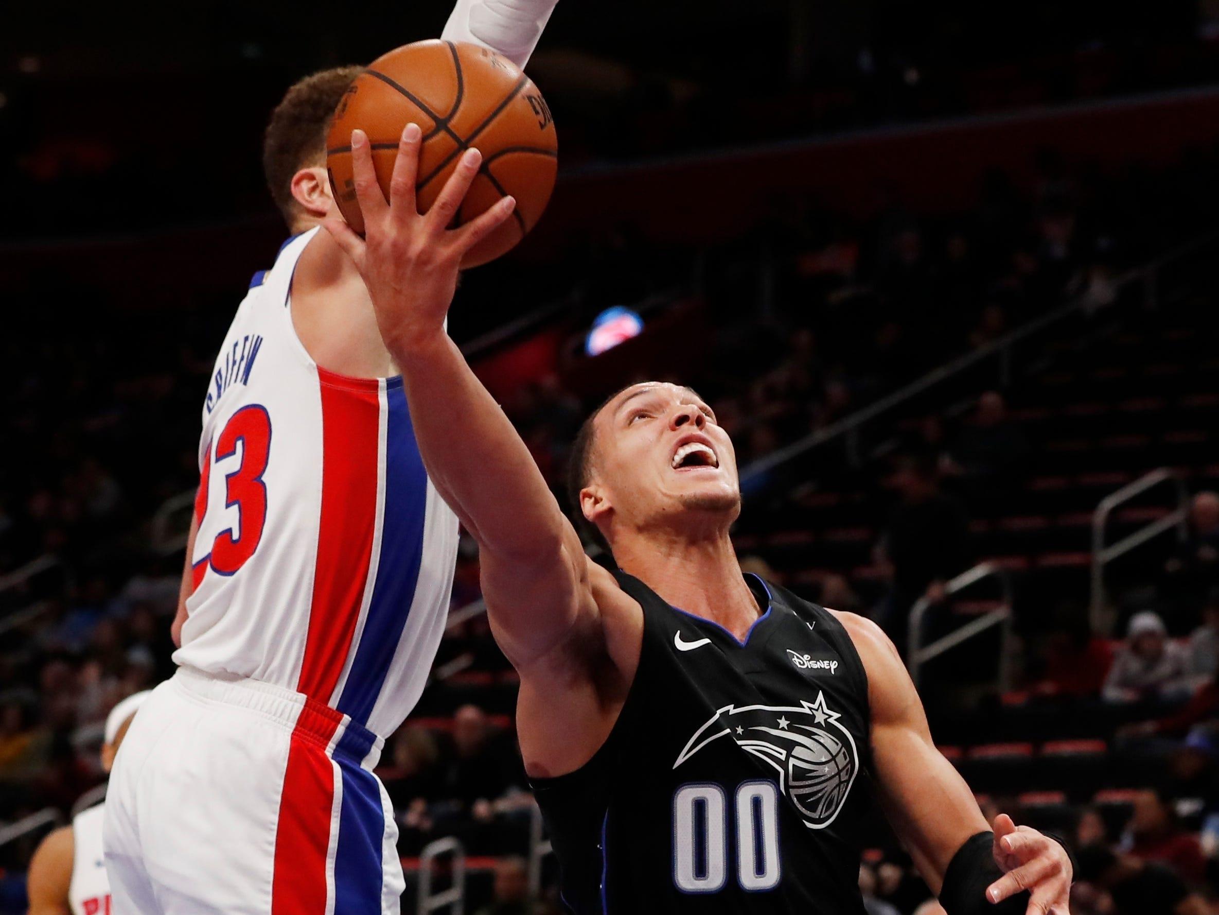 Orlando Magic forward Aaron Gordon (00) shoots as Detroit Pistons forward Blake Griffin (23) defends during the second half.
