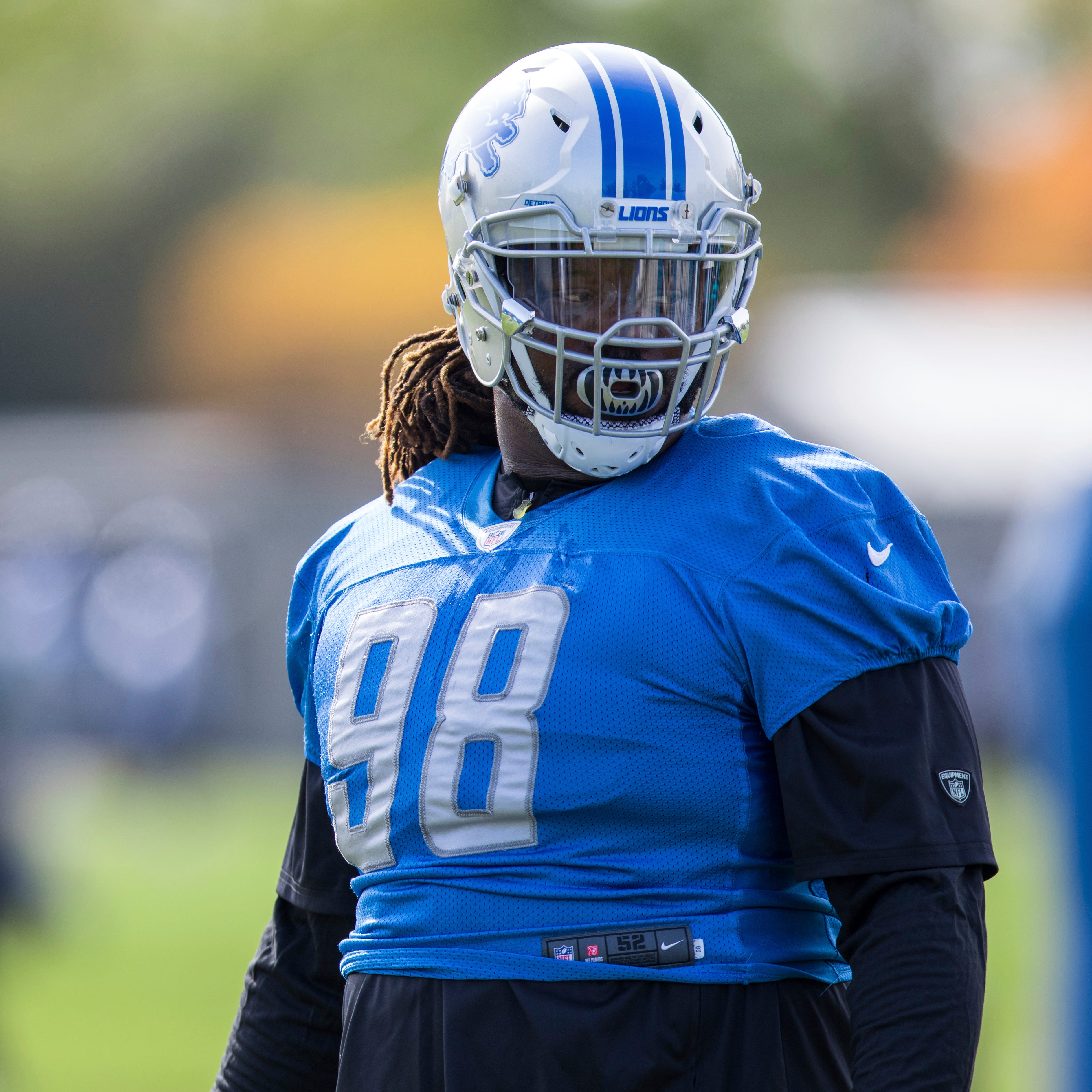 Lions say Harrison's offseason absence not related to contract
