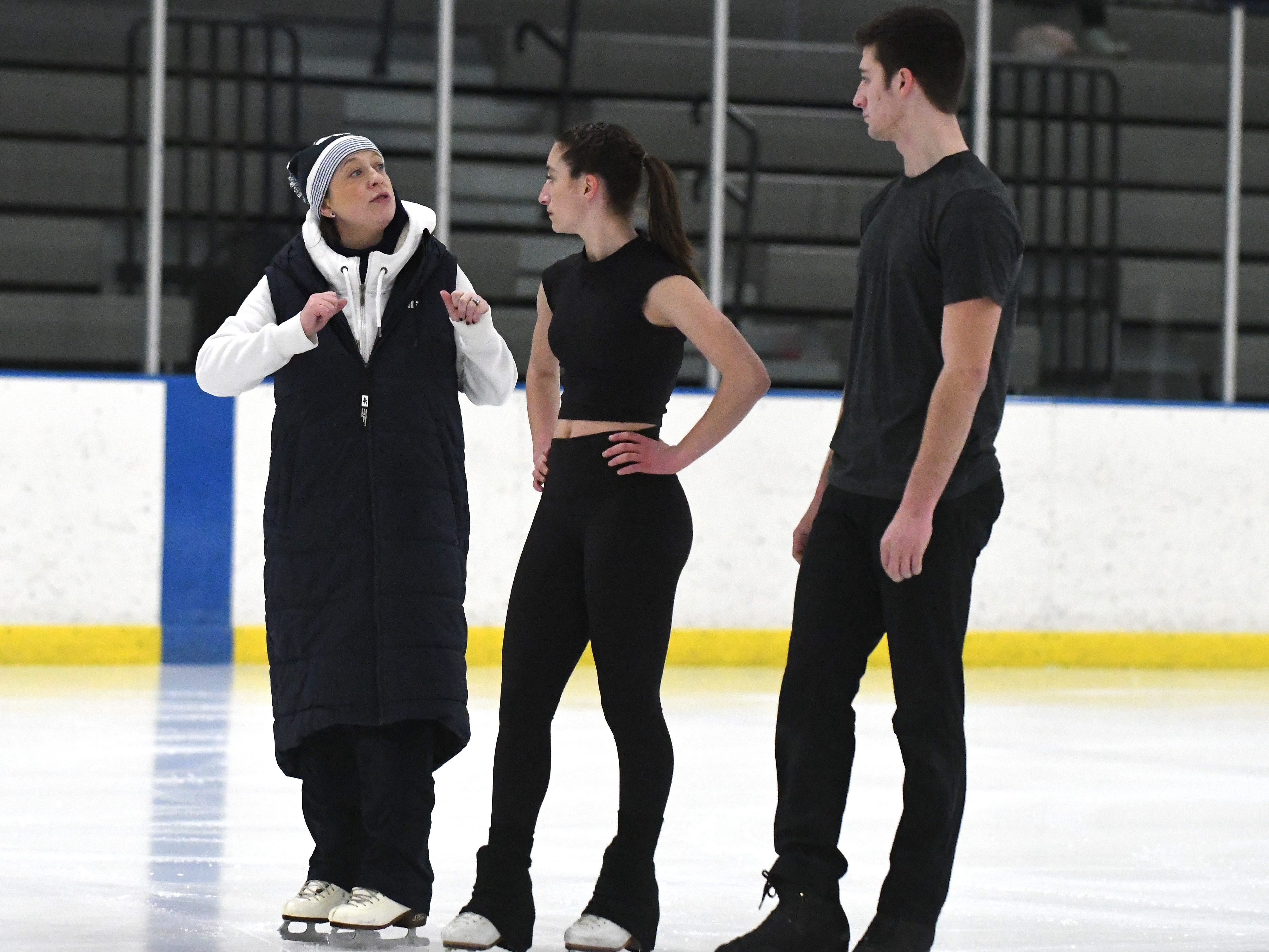 Coach Zuzanna Parchem works with Isabelle Goldstein and Keyton Bearinger during practice.