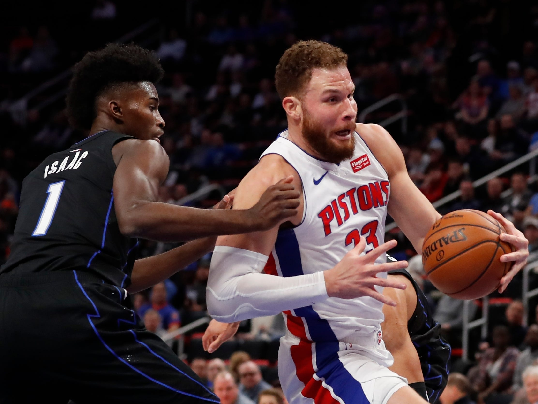 Detroit Pistons forward Blake Griffin (23) drives as Orlando Magic forward Jonathan Isaac (1) defends during the first half.