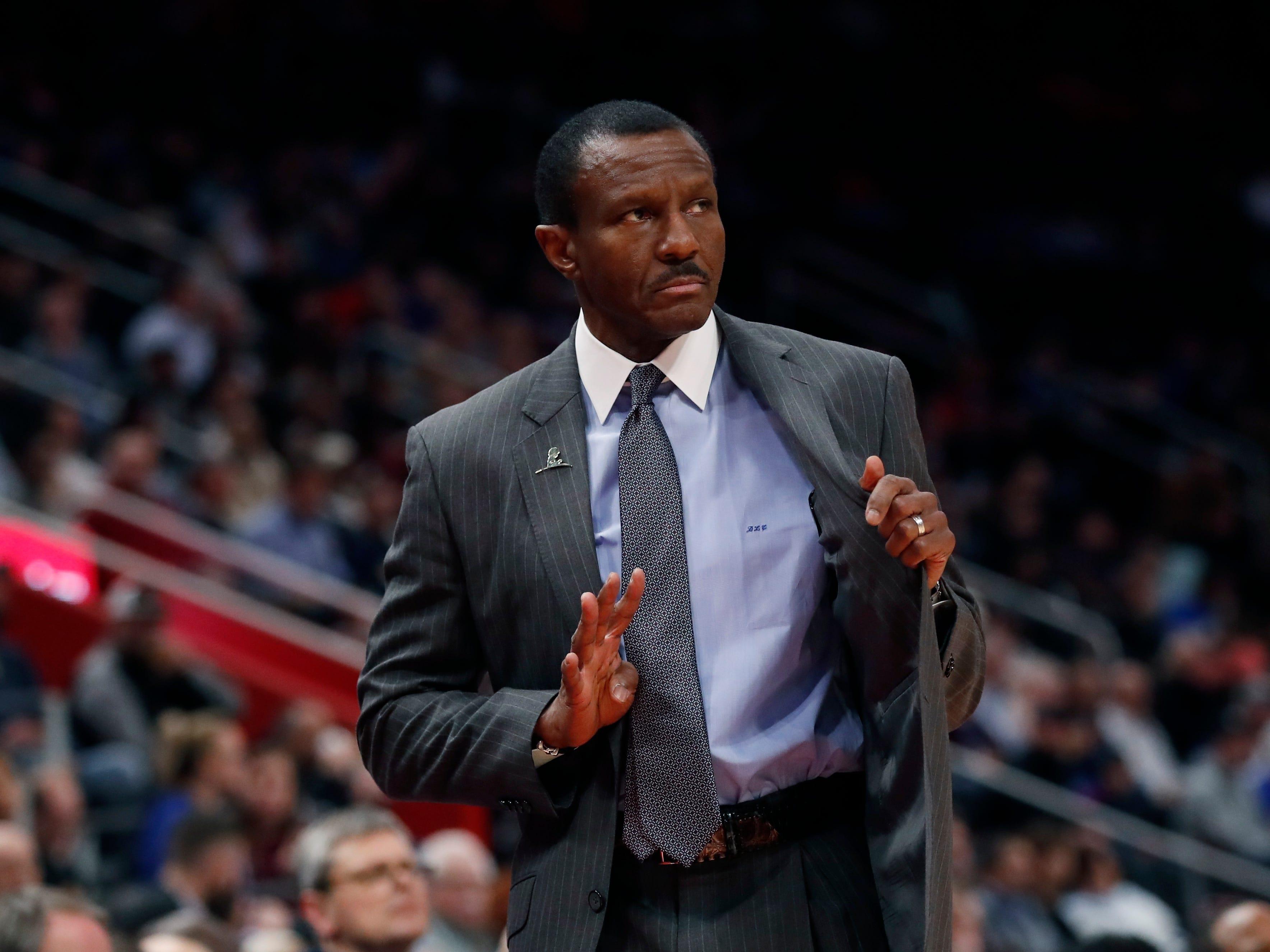 Detroit Pistons head coach Dwane Casey signals during the first half.