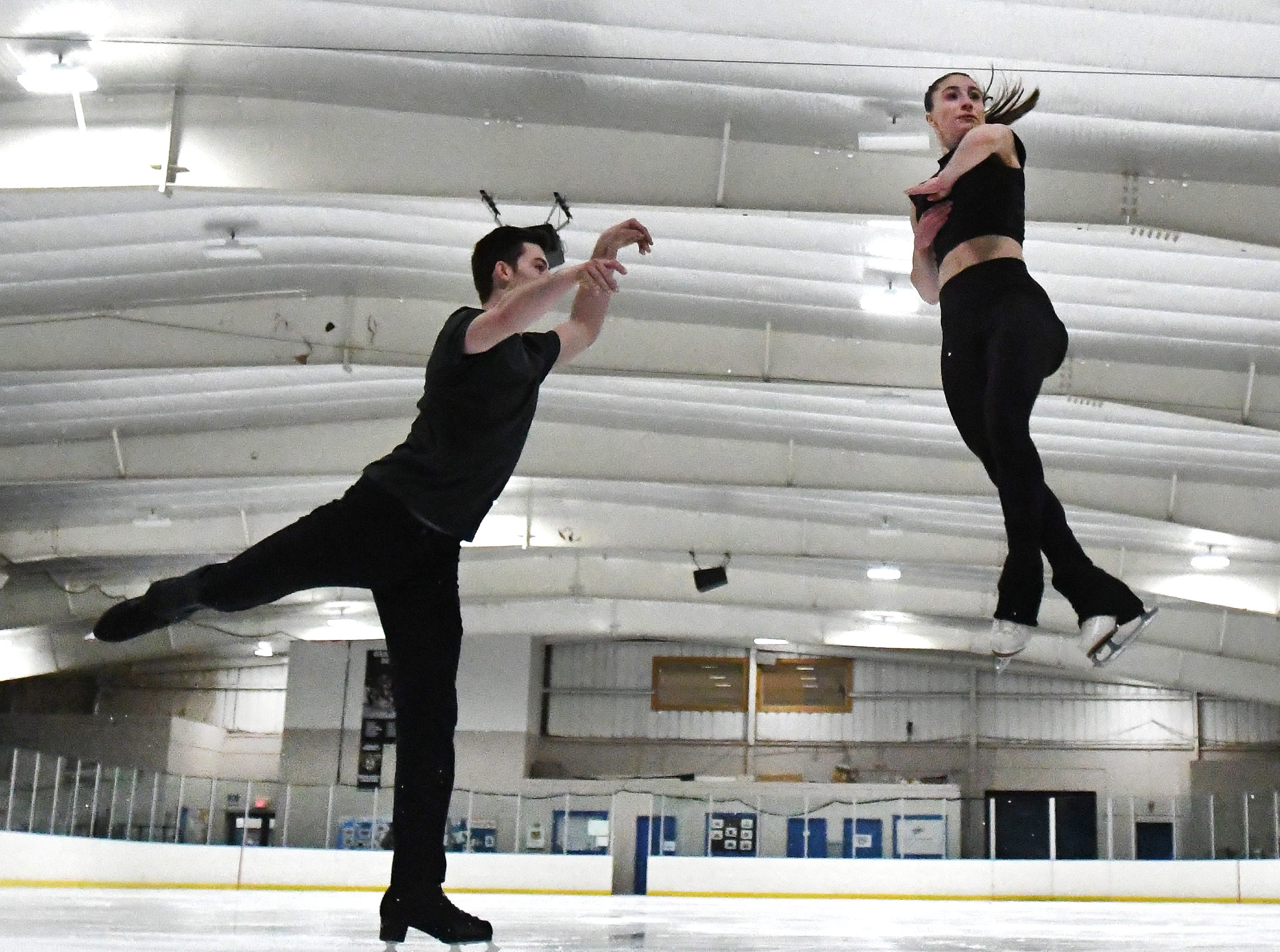 Pairs figure skaters, Midland's Keyton Bearinger and his partner Isabelle Goldstein, of Bloomfield Hills, practice at the Detroit Skating Club in Bloomfield Hills, Michigan on January 16, 2019.