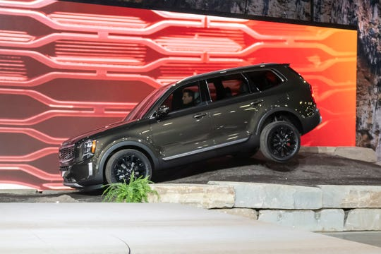 The 2020 Kia Telluride is driven on an off-road road course during its reveal.