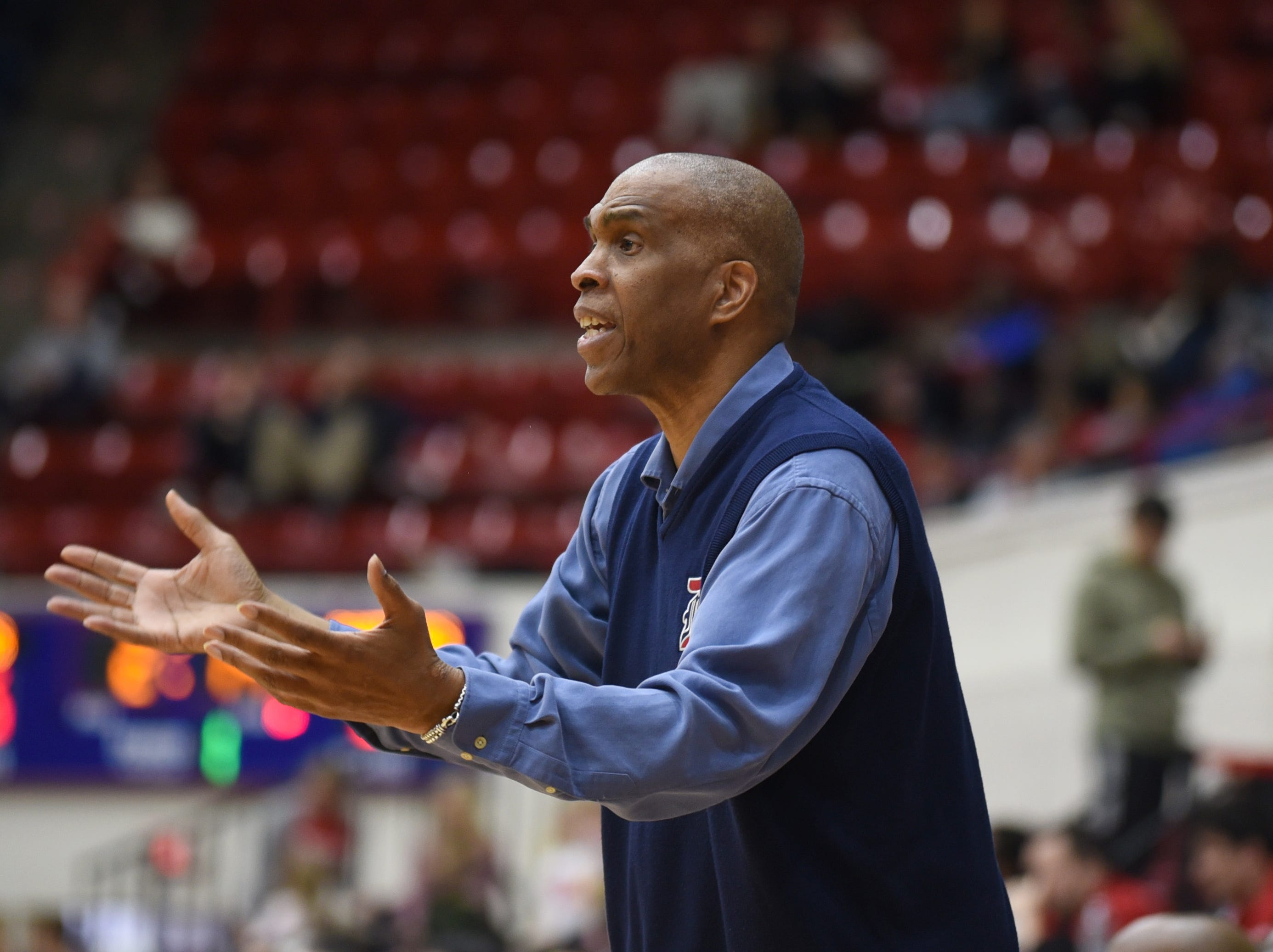 University of Detroit Mercy head basketball coach Mike Davis shouts to his players during a game against University of Milwaukee.