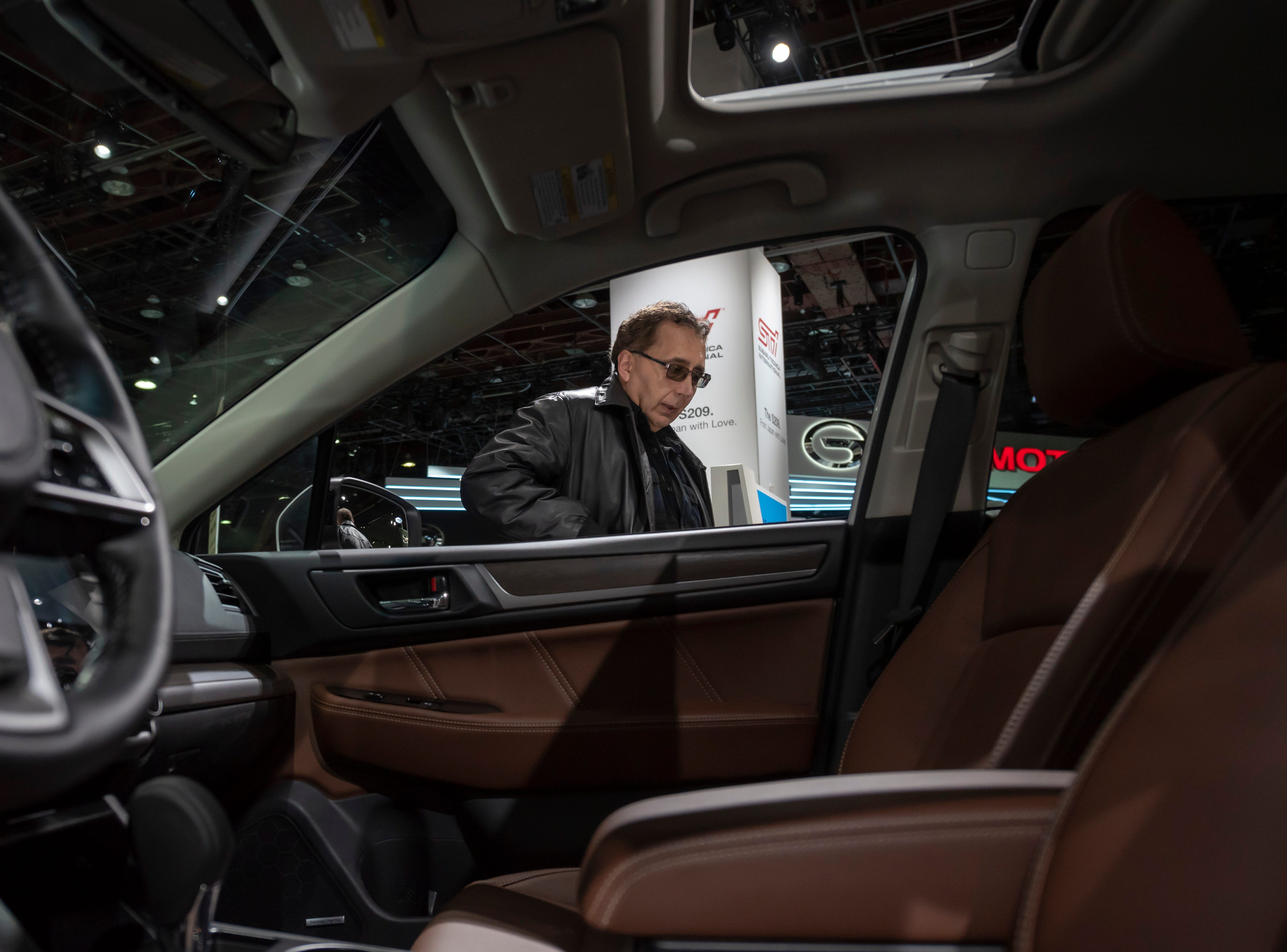 Judge Felix Fulicea of Detroit checks out the interior of the 2019 Subaru Outback.