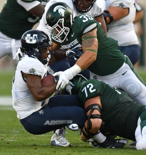 "Michigan State linebacker Joe Bachie (35) earned a spot on ESPN's ""way-too-early"" All-America team for 2019."