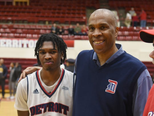 Antoine Davis, left, and his father Mike Davis, Detroit Mercy's first-year head coach.
