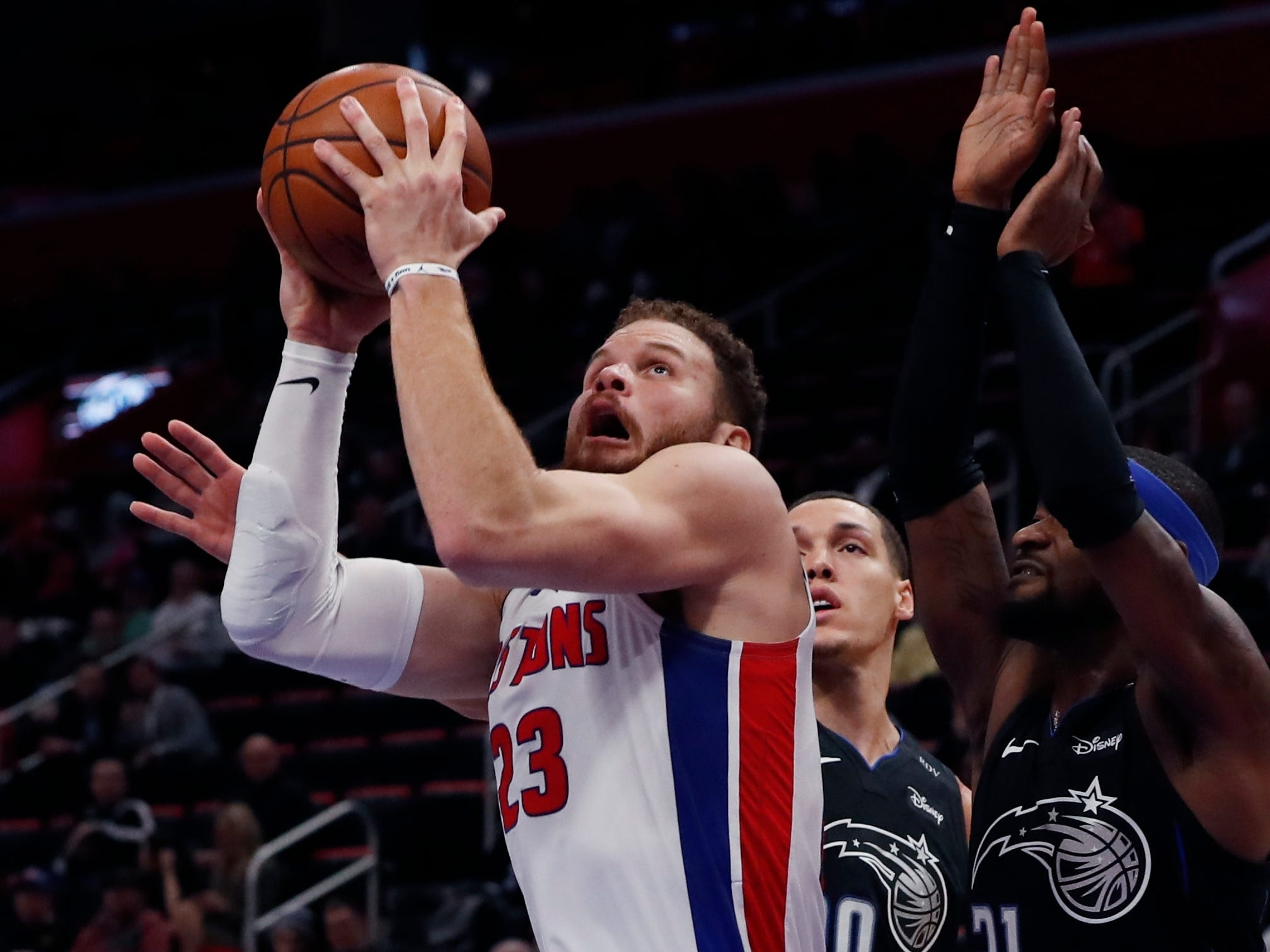 Detroit Pistons forward Blake Griffin (23) shoots as Orlando Magic forward Aaron Gordon (00) and guard Terrence Ross (31) defend during the first half.