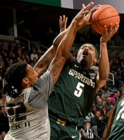 Michigan State point guard Cassius Winston earned a spot on Sports Illustrated's midseason All-America second team.