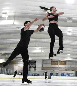 Pairs figure skaters Keyton Bearinger and Isabelle Goldstein practice at the Detroit Skating Club in Bloomfield Hills on Wednesday.