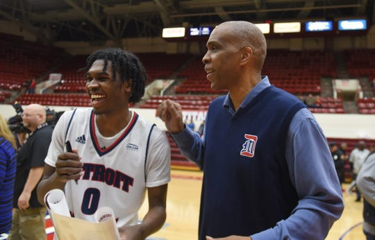 University of Detroit Mercy's Antoine Davis, left, shares a moment with his father and UDM coach Mike Davis after their win over Milwaukee on Jan. 12.